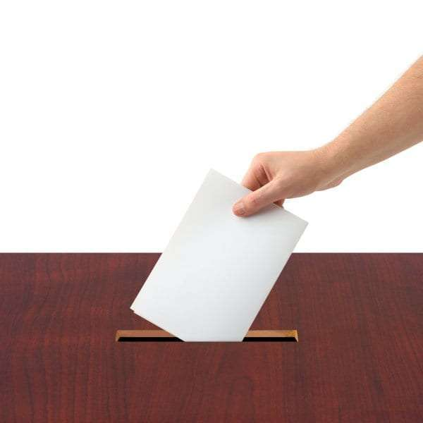 bigstock-Hand-With-Ballot-And-Box-3712271